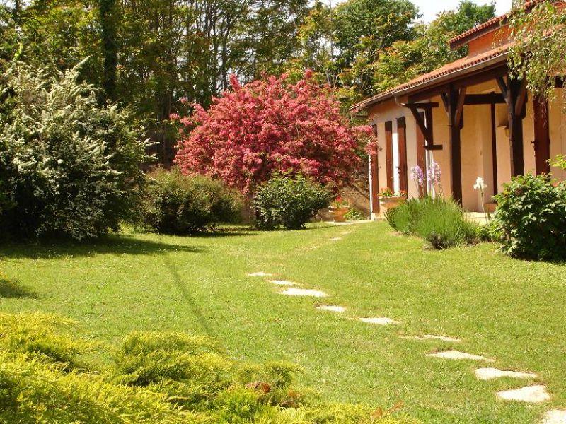 Maison à Villeneuve sur Lot semi-enterrée avec 4 chambres et garage